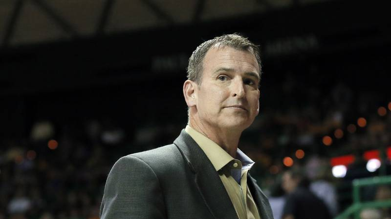 Baylor athletic director Mack Rhoades takes in play during a women's NCAA college basketball...